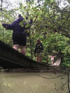 Bluffton University students enjoy the swinging bridge over the Riley Creek at the university's nature preserve, which is open daily from dawn to dusk.