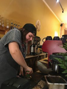 Katie Pilarsh prepares to pull a shot of espresso at Common Grounds Coffeehouse & Café on Main Street in Bluffton. Photo by Kiera Suffel