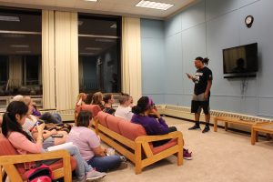 Demetrius Terry inspires the audience with poems about his life at a poetry slam in October.