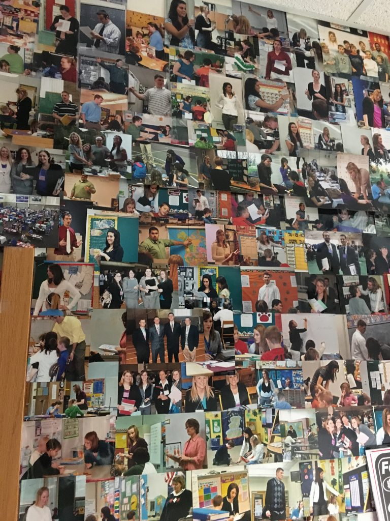 Tim Byers keeps a wall of pictures he's taken of students in the classroom in his office. Photo by Hannah Conklin