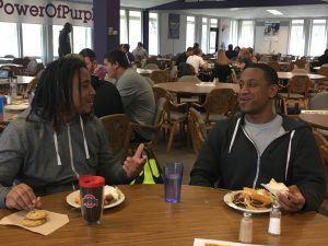 Demetrius Terry, left, and Yonas Desta eat in the Marbeck Commons. Photo by Hannah Brown